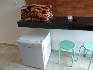 A cozinha ou cozinha compacta de Pousada Sao Caetano