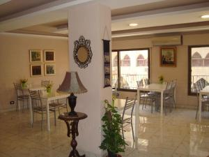 A restaurant or other place to eat at Rafi Hotel