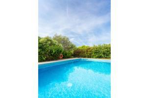 The swimming pool at or near Villa Biniparrell