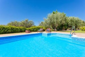 The swimming pool at or near Villa Eufrosini