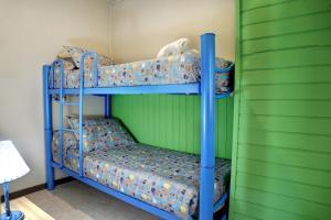 Una cama o camas cuchetas en una habitación  de Venezia