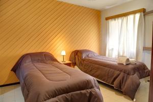 Una cama o camas en una habitación de Venezia