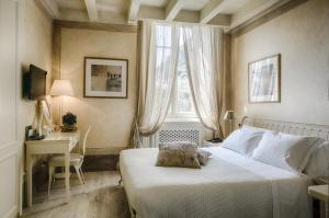 Een bed of bedden in een kamer bij Relais Villa Vittoria