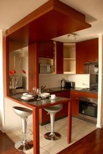 A kitchen or kitchenette at Santiago Suite Apartment