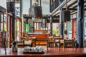 En restaurang eller annat matställe på Coffee Tree Boutique Hostel