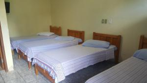 A bed or beds in a room at Hotel Blue Star II