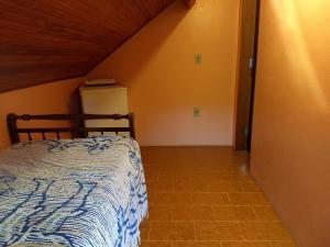 Cama ou camas em um quarto em Pousada Pedra da Gávea