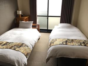 A bed or beds in a room at Eco and Tec Kyoto