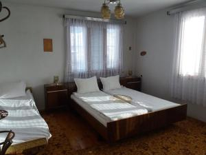 A bed or beds in a room at Guest House AHP
