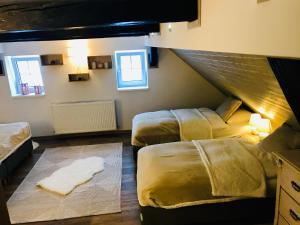 Postel nebo postele na pokoji v ubytování Chalupa Abertamy