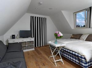 Een bed of bedden in een kamer bij Wellness Caracol