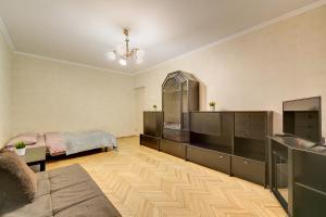 Кровать или кровати в номере Sokolniki-park Vigvam24