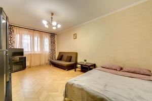 Телевизор и/или развлекательный центр в Sokolniki-park Vigvam24