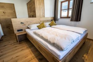 A bed or beds in a room at AusZeit
