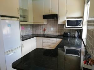 A kitchen or kitchenette at Maroela House Guest Accommodation