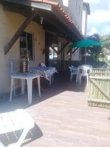 A balcony or terrace at Paraiso em Iheus