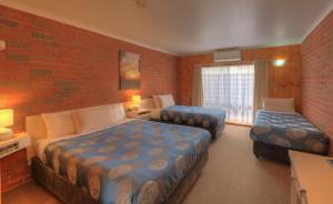 A bed or beds in a room at Kyabram Country Motel