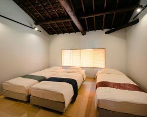 町家ホテルYANAGIにあるベッド