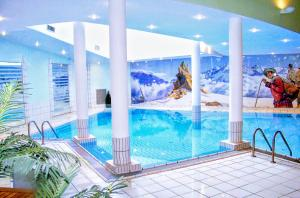 The swimming pool at or near Les Balcons du Savoy