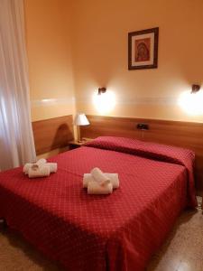 Cama ou camas em um quarto em Casa La Salle - Casa Religiosa