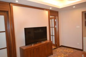 A television and/or entertainment center at Primus Hotel Kaloum