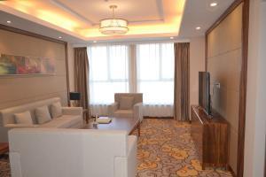 A seating area at Primus Hotel Kaloum