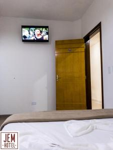 A bed or beds in a room at Hotel Jem