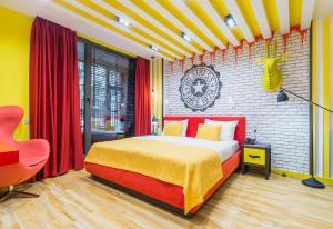 Кровать или кровати в номере Бутик-отель Зеленый Театр