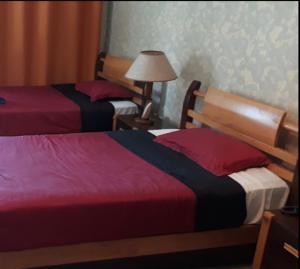 A bed or beds in a room at Dar El Aaz