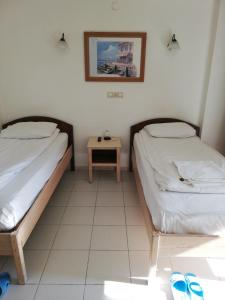 A bed or beds in a room at AY OTEL 2