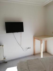 A television and/or entertainment center at AY OTEL 2