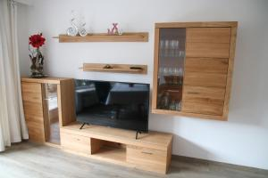 A television and/or entertainment centre at Alpen - Apartments