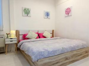 En eller flere senge i et værelse på Banyan House Samui bed and breakfast (Adult Only)