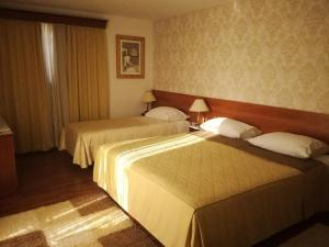A bed or beds in a room at Hotel ZaDar