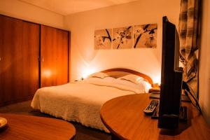 Posteľ alebo postele v izbe v ubytovaní Penzión Pod Hradom