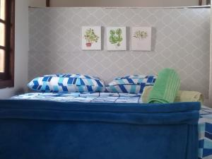 A bed or beds in a room at Buganville Loft