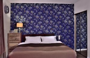 Łóżko lub łóżka w pokoju w obiekcie Apartamenty Sjesta Centrum