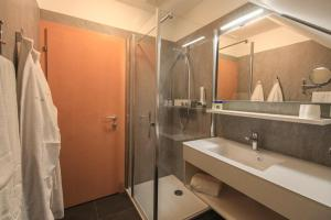 Ein Badezimmer in der Unterkunft Hotel Garni Thermenoase