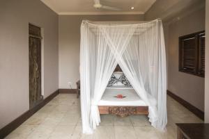 Un ou plusieurs lits dans un hébergement de l'établissement Honeymoon Guesthouse