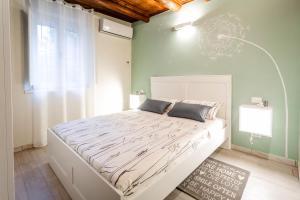 Letto o letti in una camera di Salvia e Senape Ferrara