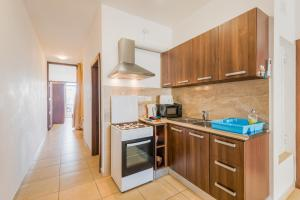 A kitchen or kitchenette at Seashells Apartments with terrace, just off the seafront in Bugibba - by Getawaysmalta