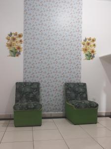 A seating area at Chácara Pousada Sagui