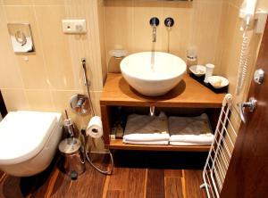 A bathroom at Jūros Apartamentai