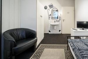 Ein Sitzbereich in der Unterkunft Hotel Tusculum