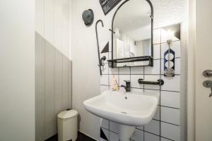 Ein Badezimmer in der Unterkunft Hotel Tusculum