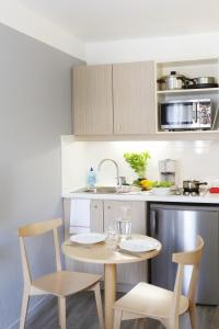 A kitchen or kitchenette at Aparthotel Adagio Access Marseille Prado Périer