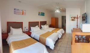 Ein Bett oder Betten in einem Zimmer der Unterkunft hotel pension steiner