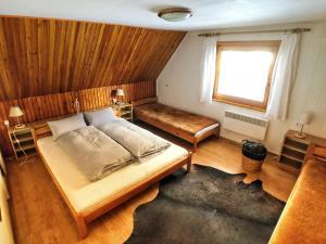 Postel nebo postele na pokoji v ubytování Chata Jana Demänovská Dolina