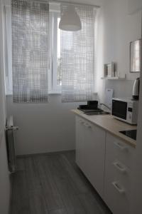 Kuchyň nebo kuchyňský kout v ubytování Nora 2