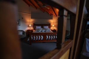 A bed or beds in a room at The Lodges